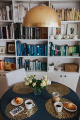 kaboompics_Round breakfast table with white flowers by the bookcase (1).jpg